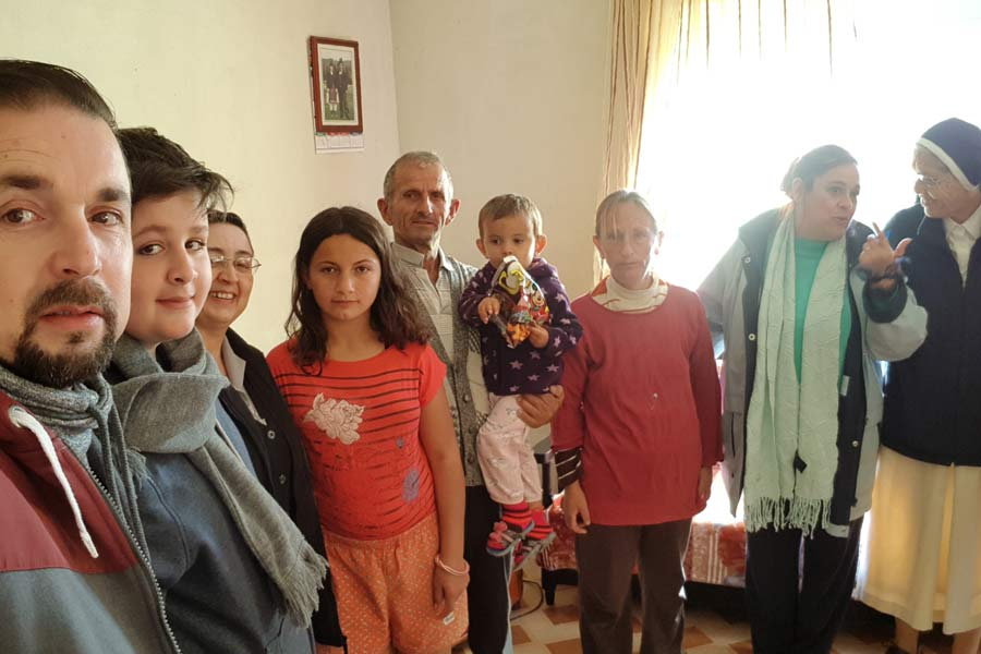 Smiling with Jerome visit families in Albania Nov. 2017